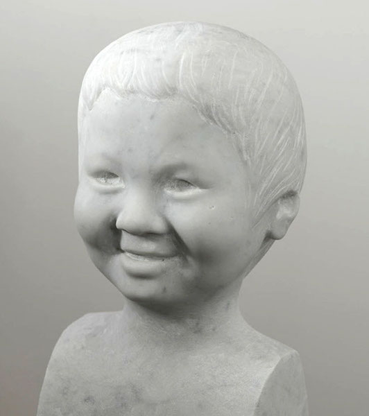 This is a portrait carved directly into carrara marble by UK portrait painter, commissioned in 2010